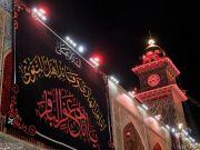 Photos: Imam Ali's (A.S) holy shrine covered with black on martyrdom anniversary of Imam Al-Baqir (A.S)